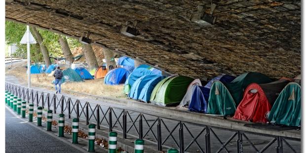 Migrant tents under a bridge in Europe