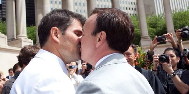 Two gay men at a wedding