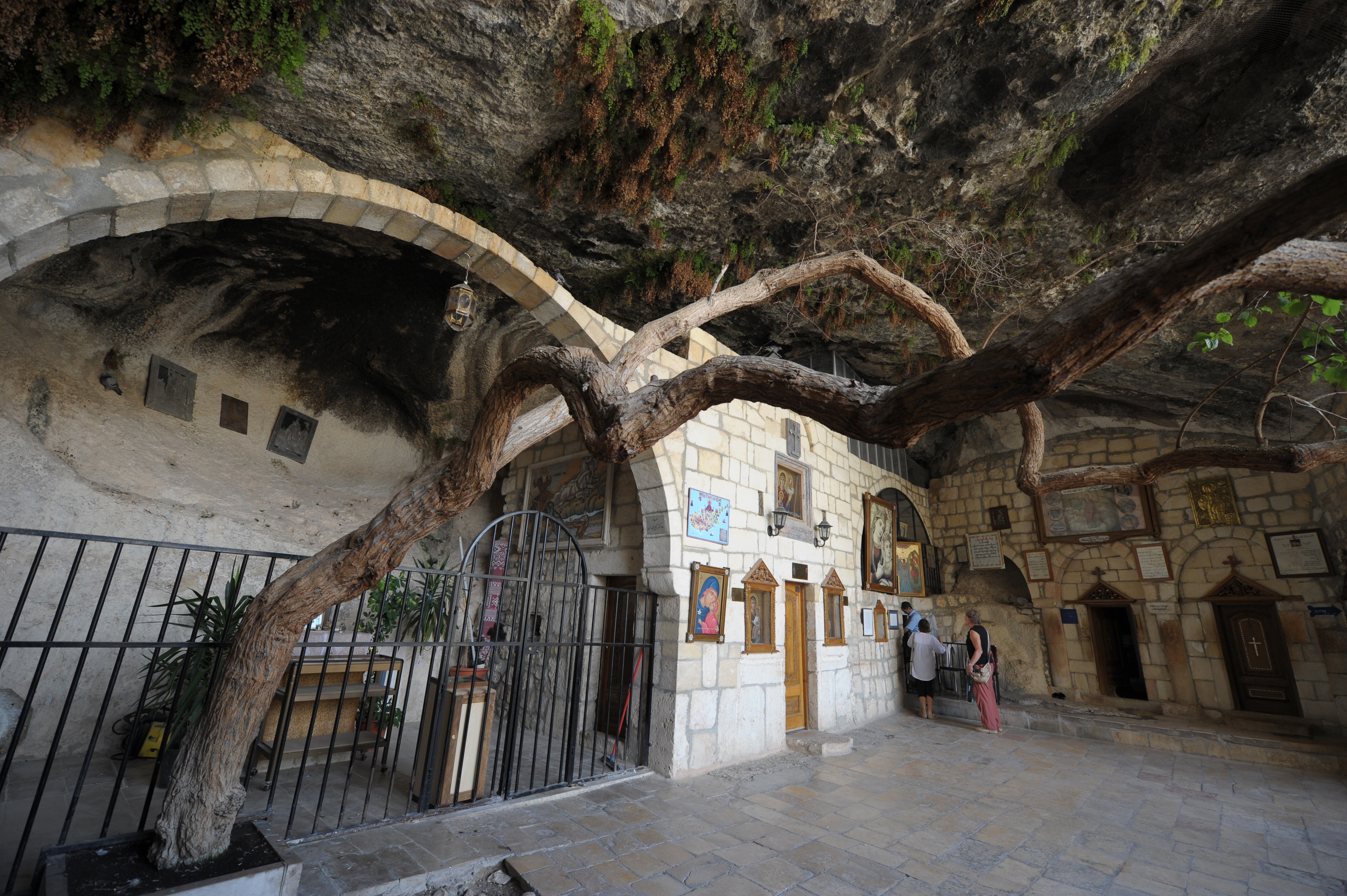Monastery of Saint Taqla (Thecla), a pupil of St.Paul, that was built around the crypt carved in a mountain, with a sacred icon. Ma'loula.