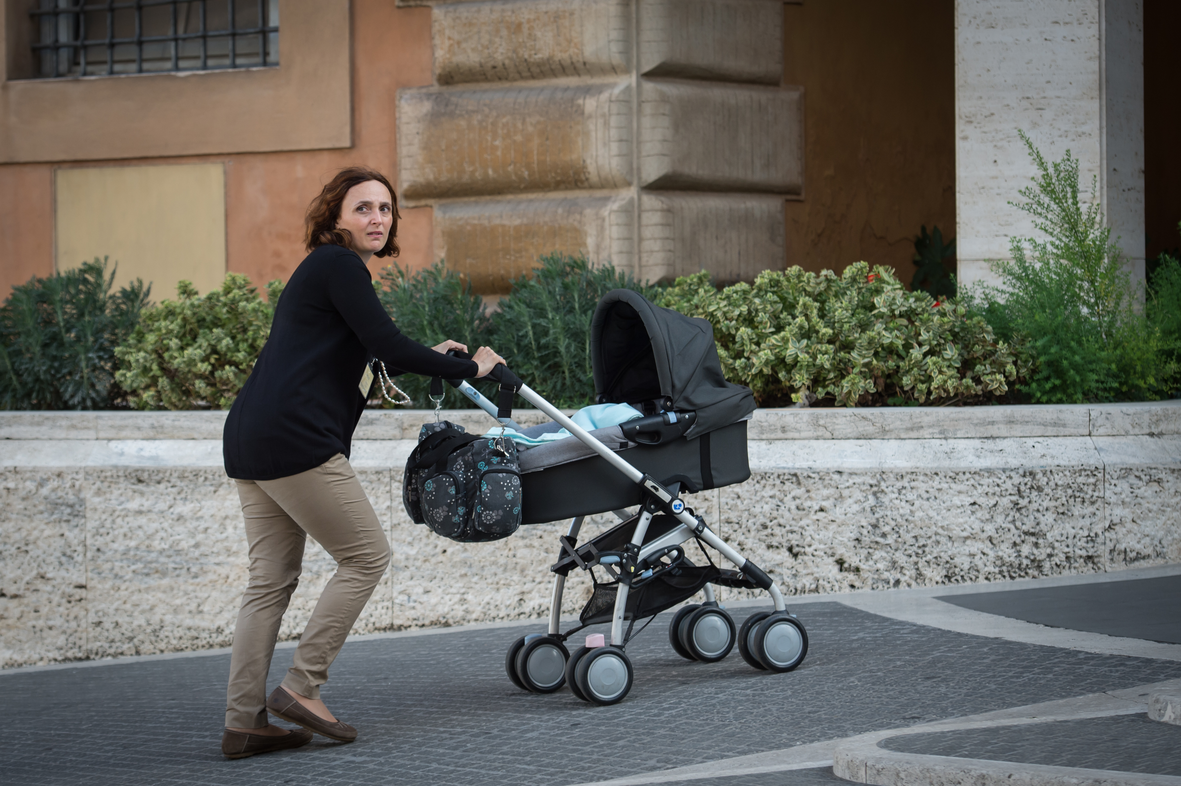 Patricia Paloni pushes 4 month old son Davide toward Synod of Bishops