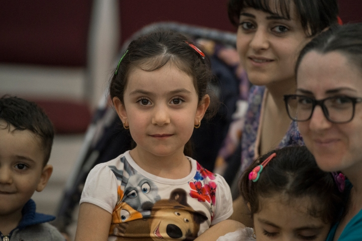 Mara, Anna, Alak, and their children taking a few minutes to share about their arrival in Jordan twenty days ago.