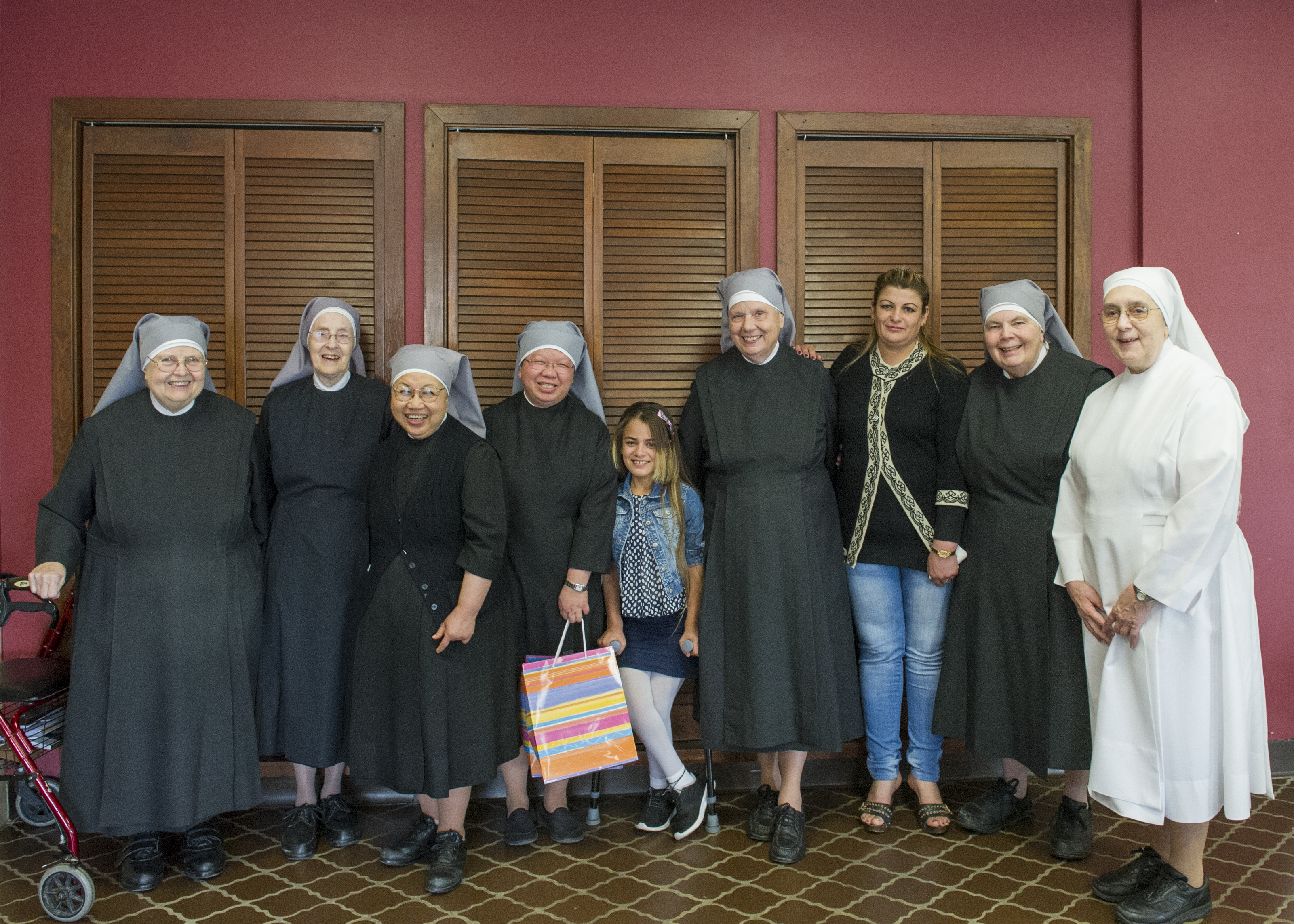 Katrina and her mother, Rajaa, Chaldeans from Iraq, with some of the Little Sisters of the Poor in the St. Joseph's Residence in Enfield, CT
