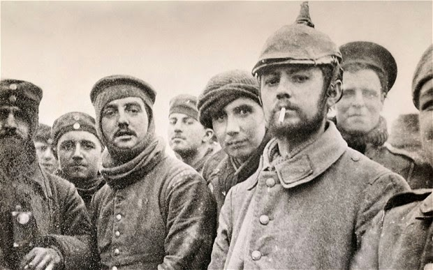 German, French and British soldiers pose for a photo, play soccer and share smokes on Christmas Day 1914.