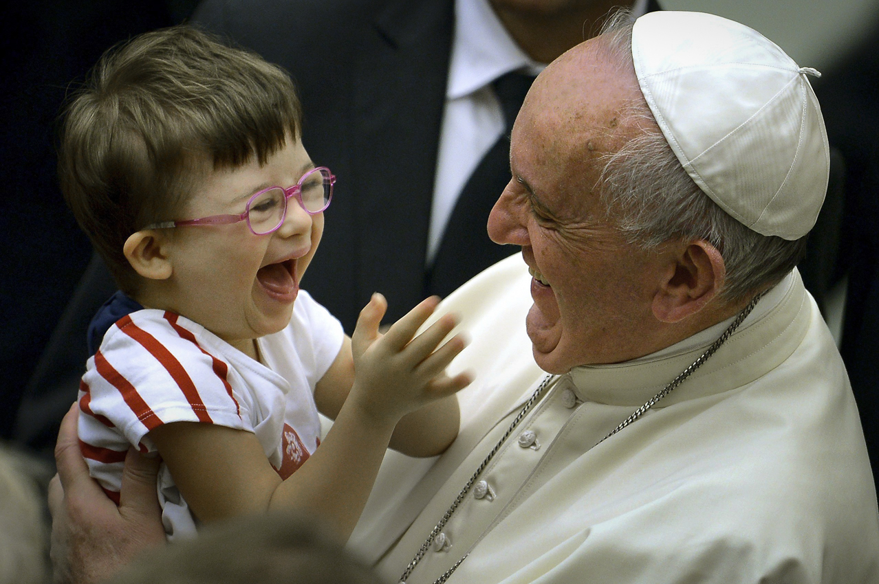 ROME,ITALY: Pope Francis greets a boy during an audience with Parish Cells for Evangelization in Paul VI hall at the Vatican on September 5, 2015.   FILIPPO MONTEFORTE/AFP/Getty Images