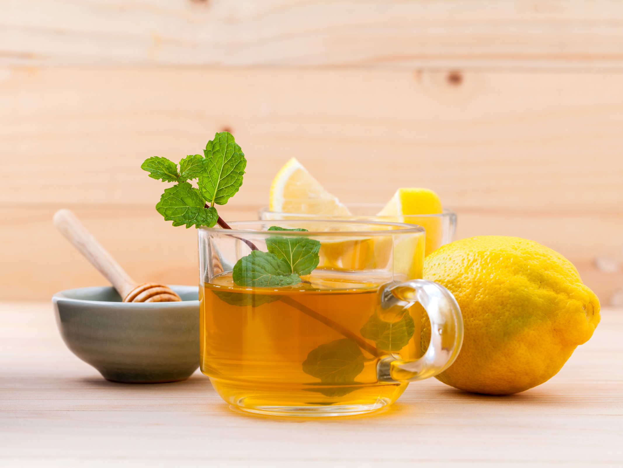 http://www.shutterstock.com/pic-311402678/stock-photo-cup-of-herbal-tea-with-fresh-green-mint-honey-and-lemon-on-wooden-background.html?src=mLB-sItxTdAyDfIfY0QjBw-2-9