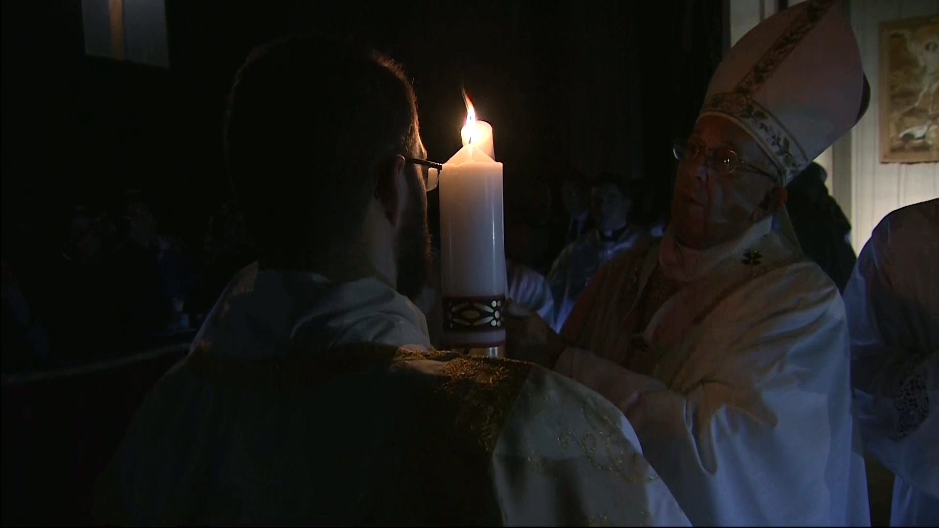 Holding up the Paschal candle at the Vatican's Easter Vigil Mass.