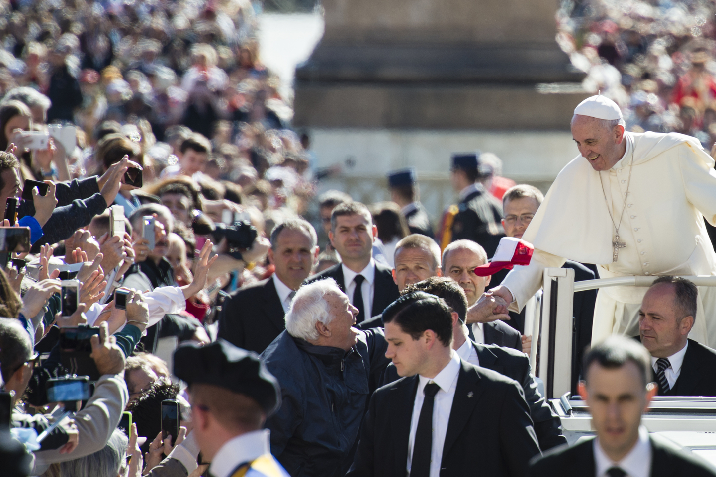 Pope Francis greets the crowd as he arrives for his weekly gener