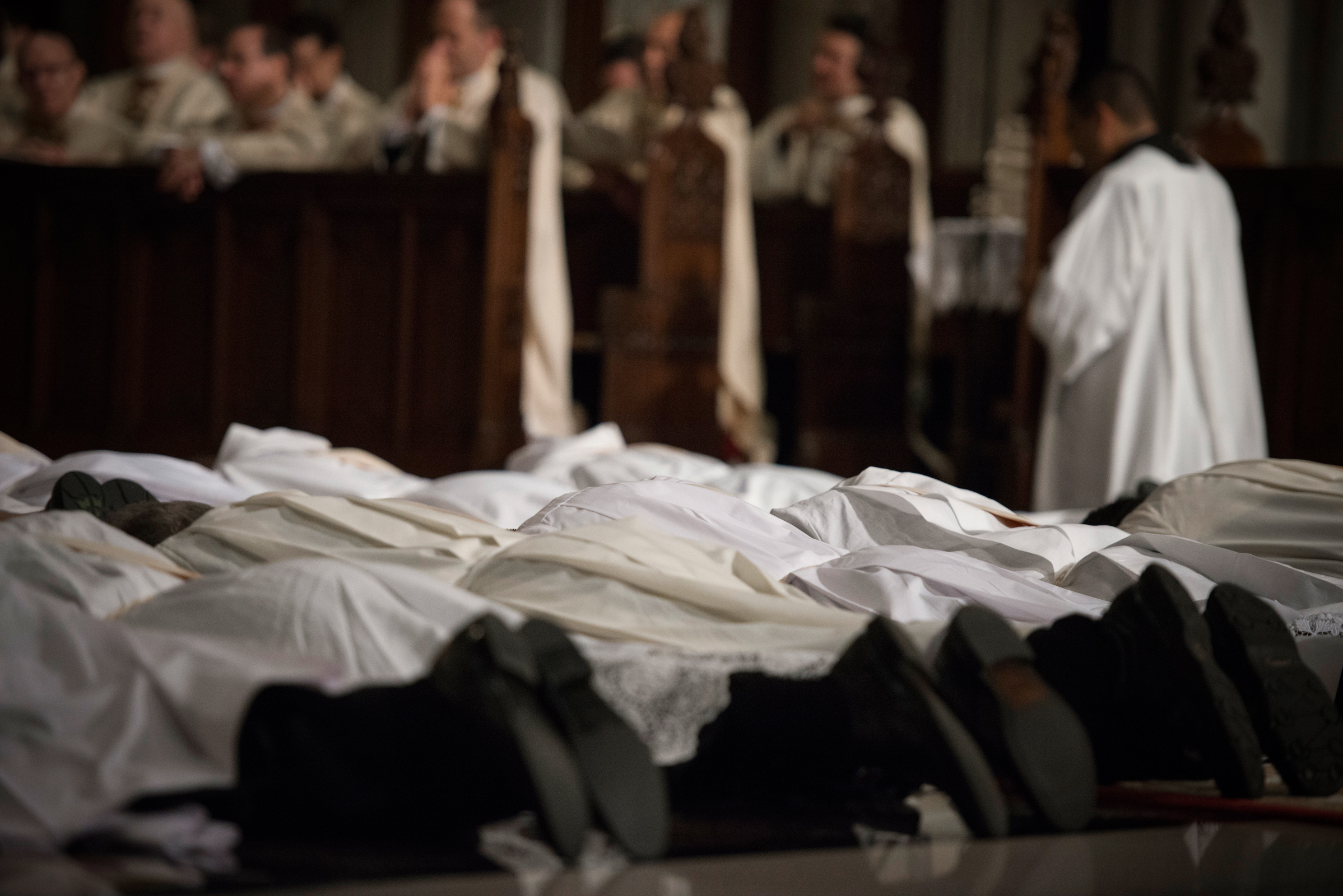 Each man prostrates himself to symbolize his unworthiness for the office to be assumed and his dependence upon God and the prayers of the Christian community. (USCCB)