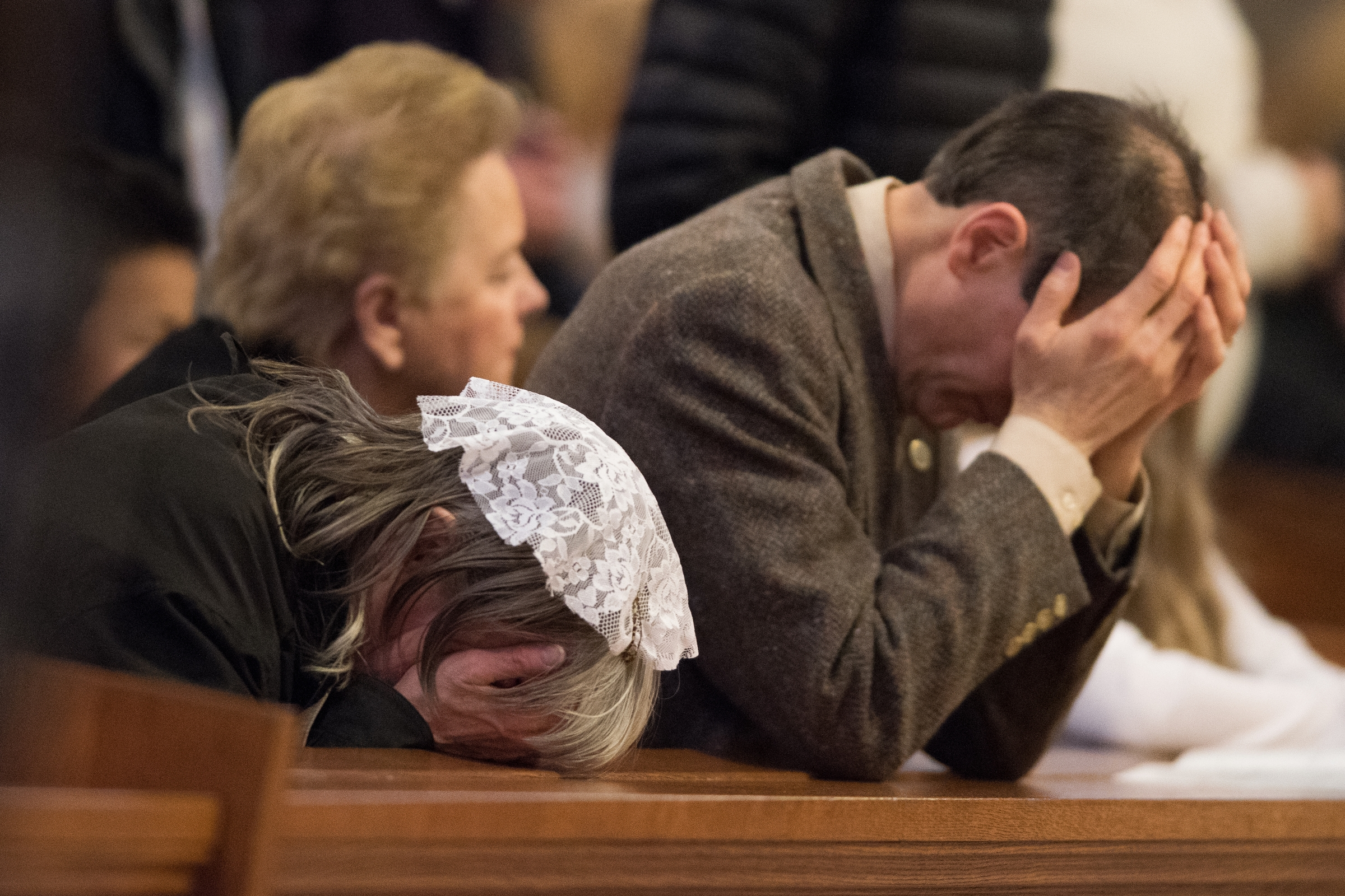 Joan Andrews Bell and her husband Chris Bell in prayer at the Good Counsel Homes 30th Anniversary Mass celebrated at the Cathedral Basilica of the Sacred Heart in Newark NJ