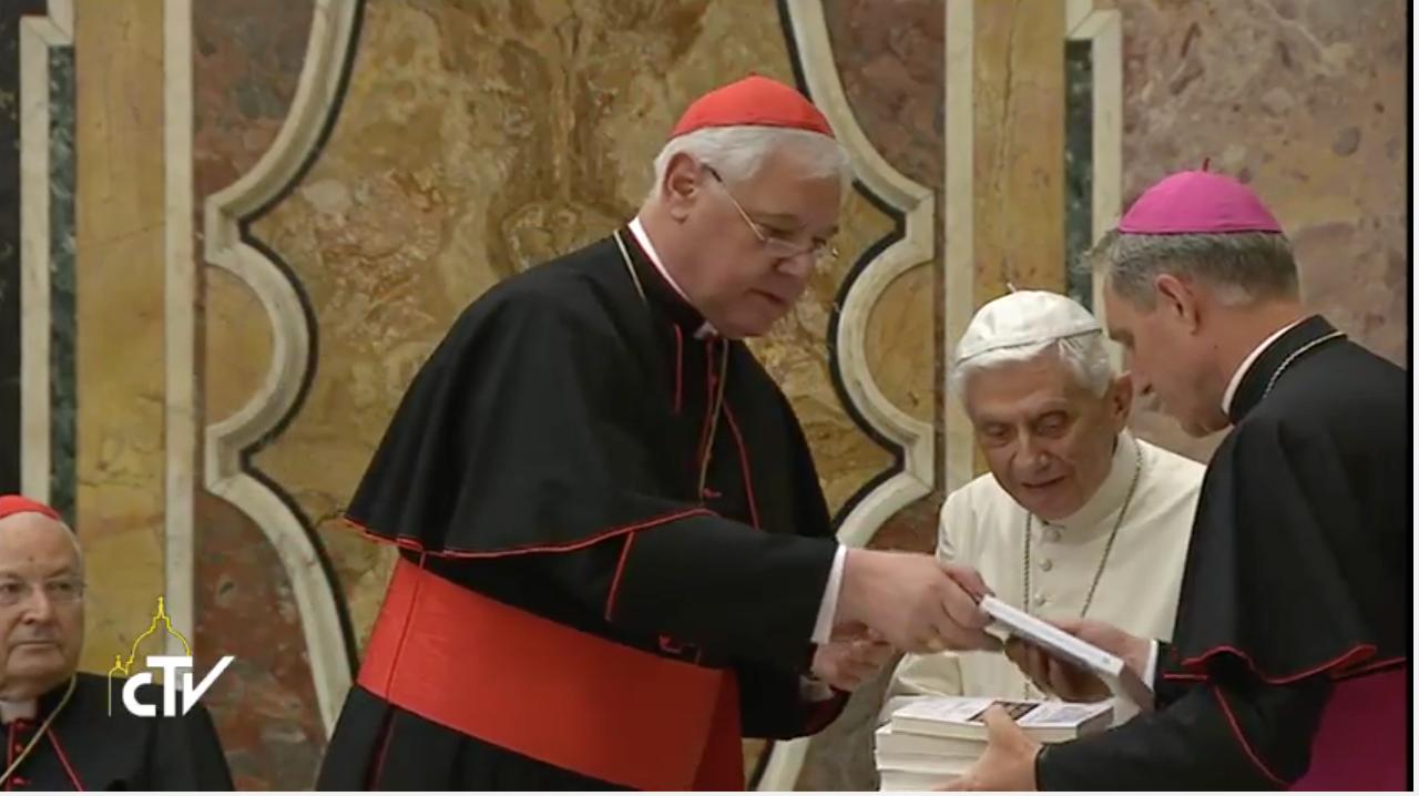Cardinal Muller gives book to Benedict XVI