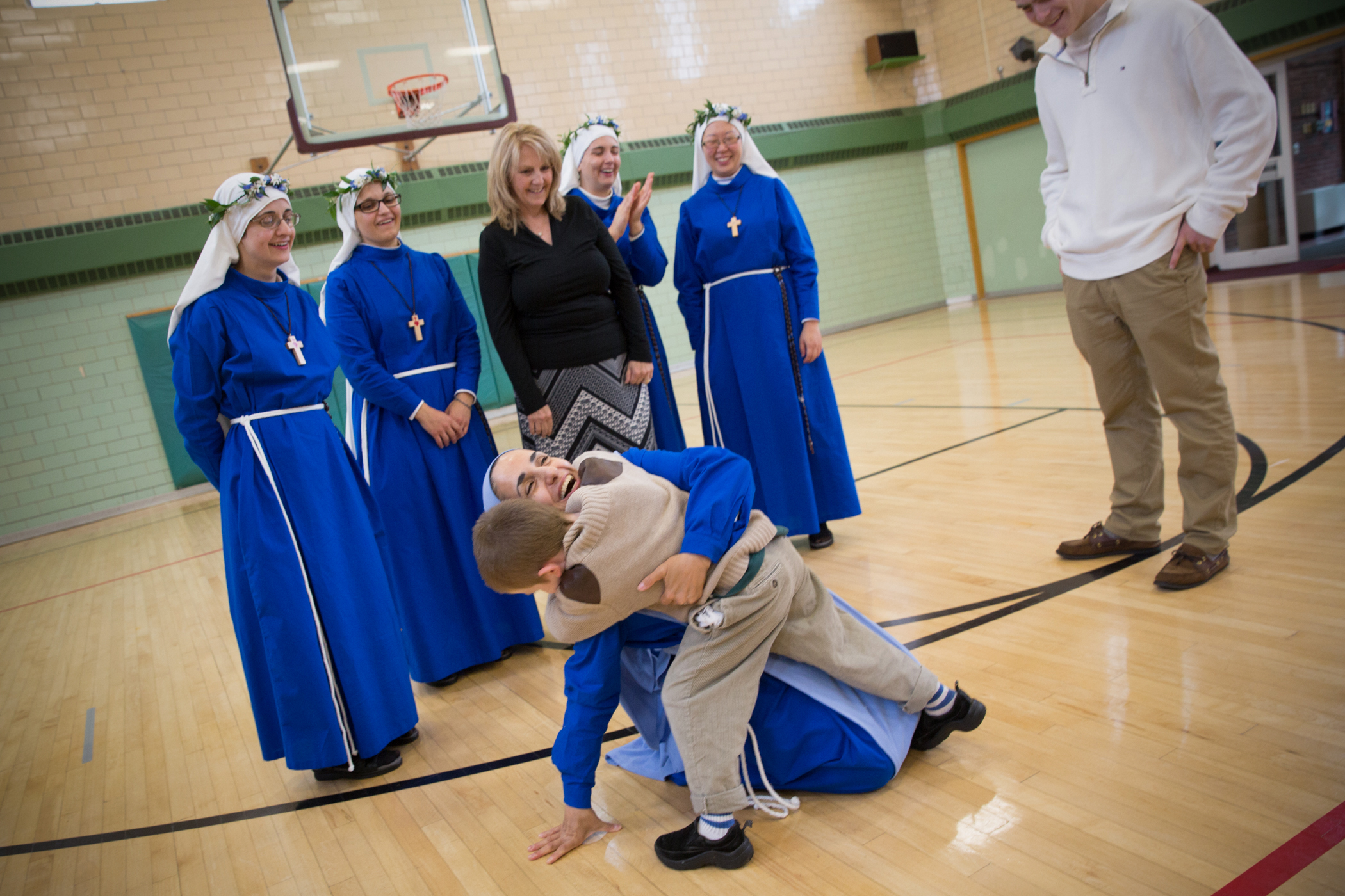 WEB-MOTHER-OLGA-HUG-BOY-George-Martell-Archdiocese-of-Boston-CC