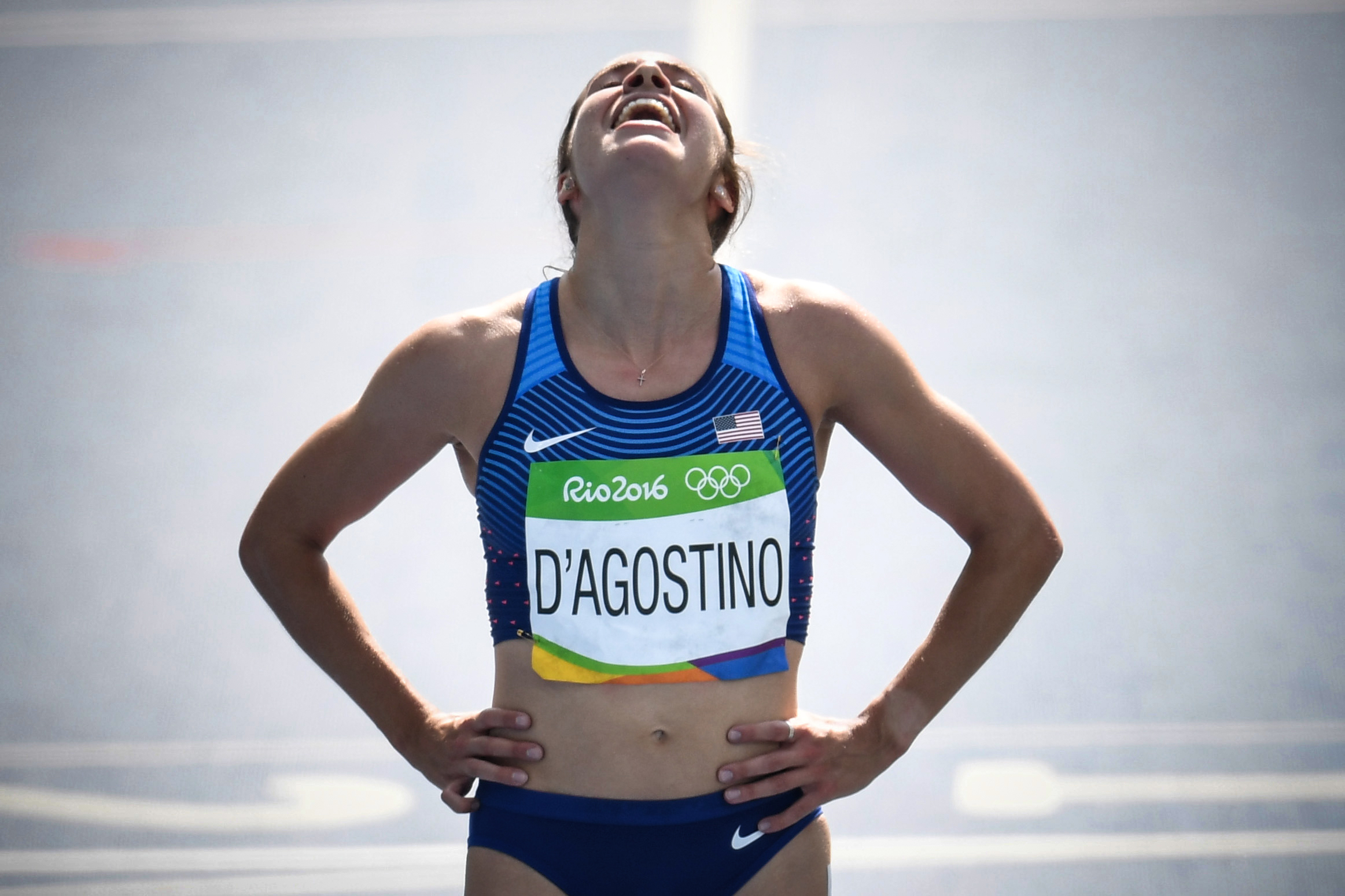 USA's Abbey D'agostino reacts after competing in the Women's 5000m Round 1 during the athletics event at the Rio 2016 Olympic Games at the Olympic Stadium in Rio de Janeiro on August 16, 2016.   / AFP PHOTO / PEDRO UGARTE