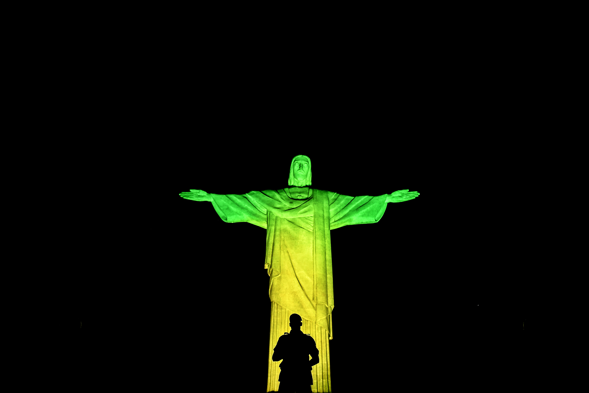 A Brazilian soldier stands guard in front of the Christ the Redeemer statue on Corcovado mountain ahead of the Rio 2016 Olympic Games in Rio de Janeiro on August 4, 2016. / AFP / JEFF PACHOUD        (Photo credit should read JEFF PACHOUD/AFP/Getty Images)