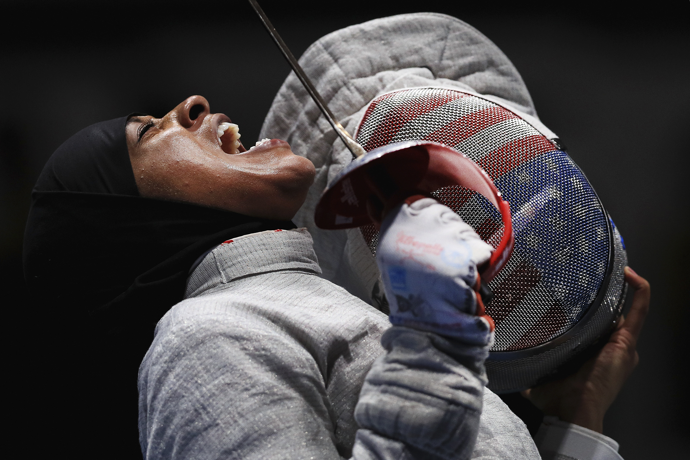 RIO DE JANEIRO, BRAZIL - AUGUST 13:  Ibtihaj Muhammad of the United States reacts against Sofya Velikaya of Russia during the Women's Sabre Team Semifinal 1 Russia vs United States at Carioca Arena 3 on August 13, 2016 in Rio de Janeiro, Brazil.  (Photo by Tom Pennington/Getty Images)