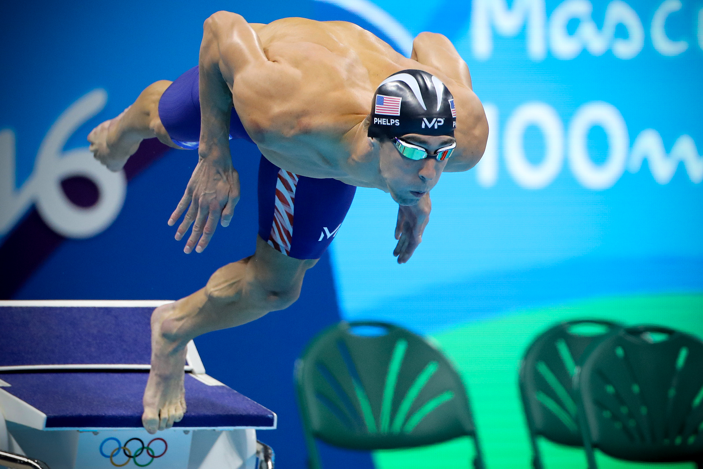 Swimming - Olympics: Day 7  Michael Phelps of the United States dives in at the start of the Men's 100m Butterfly Final during the swimming competition at the Olympic Aquatics Stadium August 12, 2016 in Rio de Janeiro, Brazil. (Photo by Tim Clayton/Corbis via Getty Images)