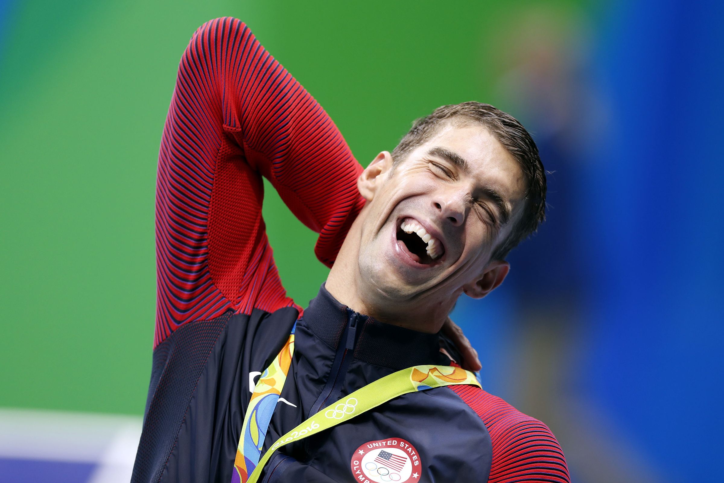 Michael Phelps of the United States of America reacts during the awarding ceremony for men?s 4x200m freestyle relay final of swimming at the 2016 Rio Olympic Games in Rio de Janeiro, Brazil, on Aug. 9, 2016. The U.S. won the gold medal with 7 minute 0.66 seconds. / CHINA OUT