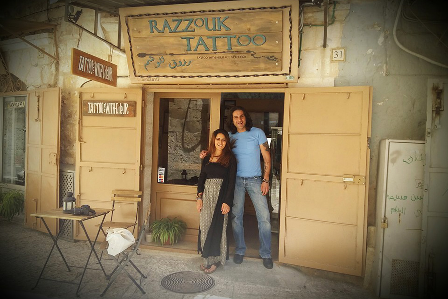 The Old City is home to the Razzouk's tattoo shop. A sign on the door identifies it unequivocally: tattoo with heritage since 1300.