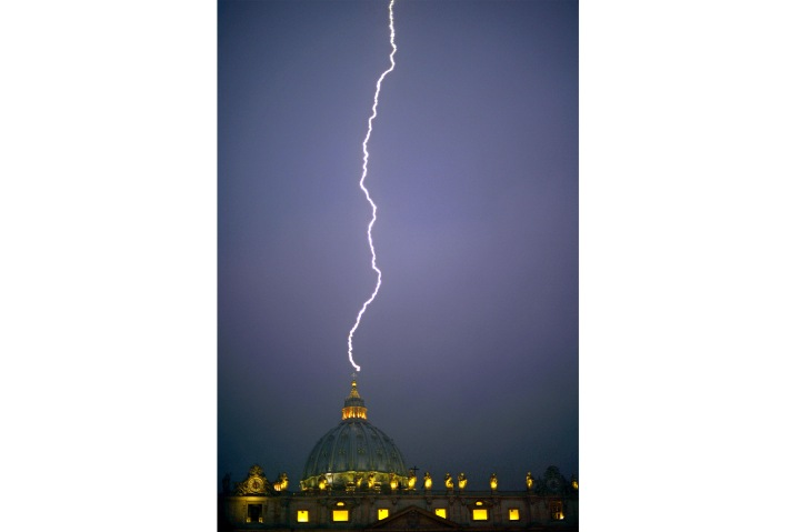 Lightning strikes St Peter's dome at the Vatican on February 11, 2013. AFP PHOTO / FILIPPO MONTEFORTE / AFP PHOTO / FILIPPO MONTEFORTE