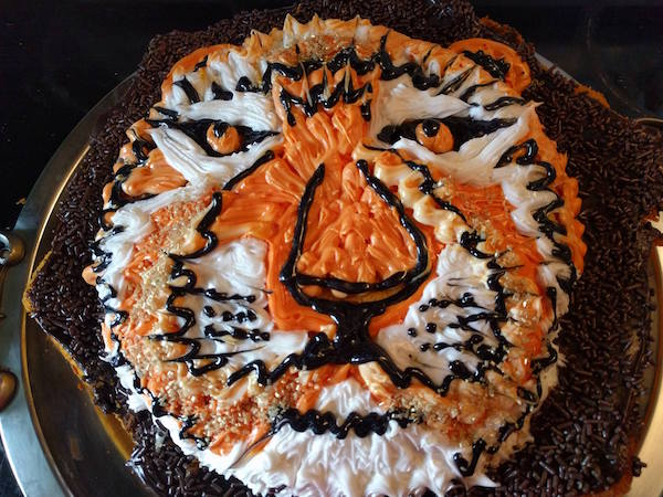 irritable tiger cake has had about enough of you young person's noise