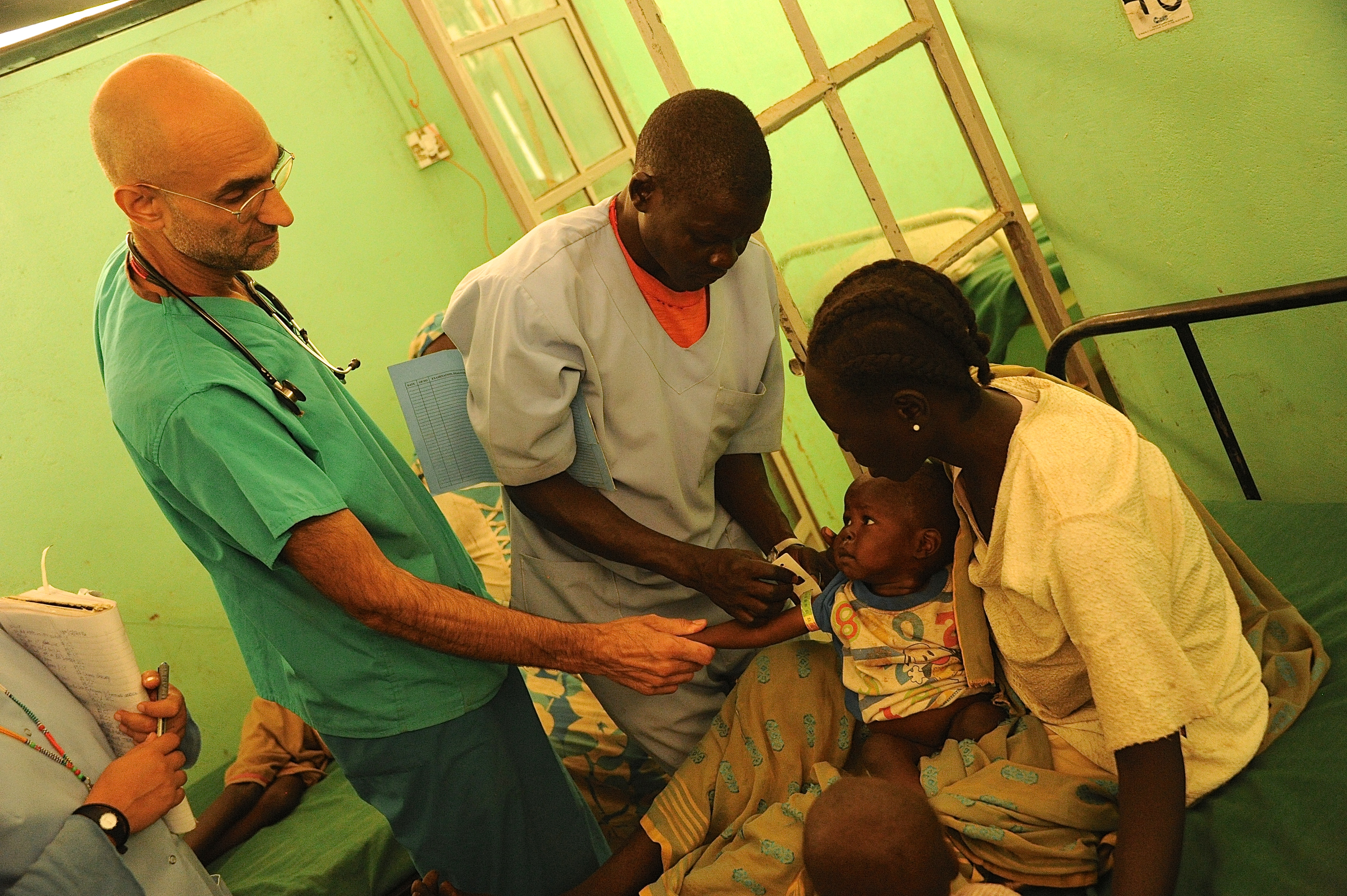 Dr. Tom Catena sees a young patient at Mother of Mercy