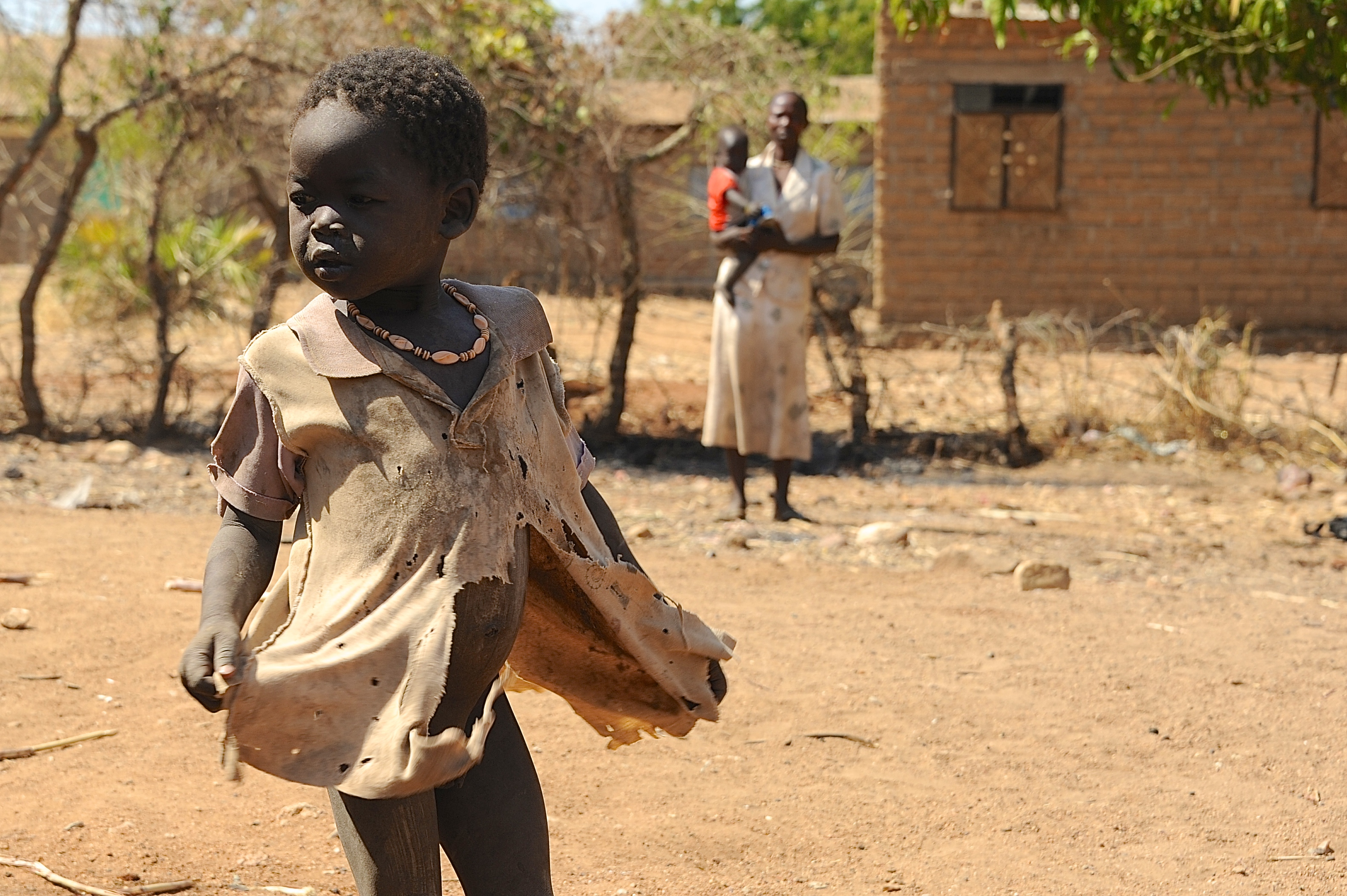 A mother watches over her child in South Kordofan State, Sudan