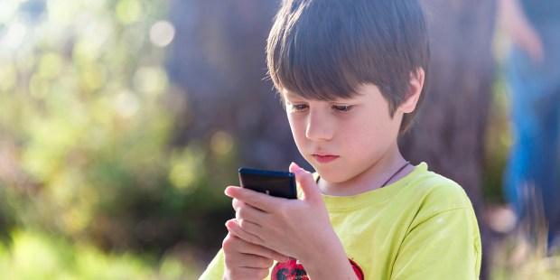 LITTLE BOY ON SMARTPHONE