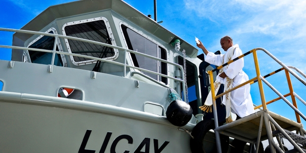 PRIEST BLESSES BOAT