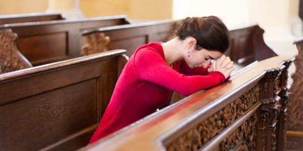 SAD WOMAN IN CHURCH