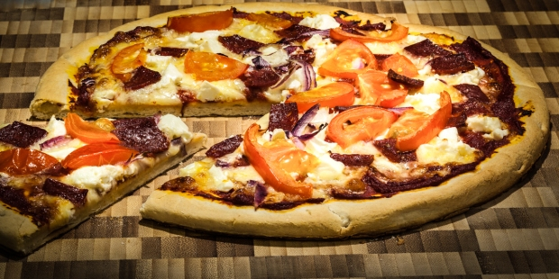 PIZZA WITH CUT SLICE