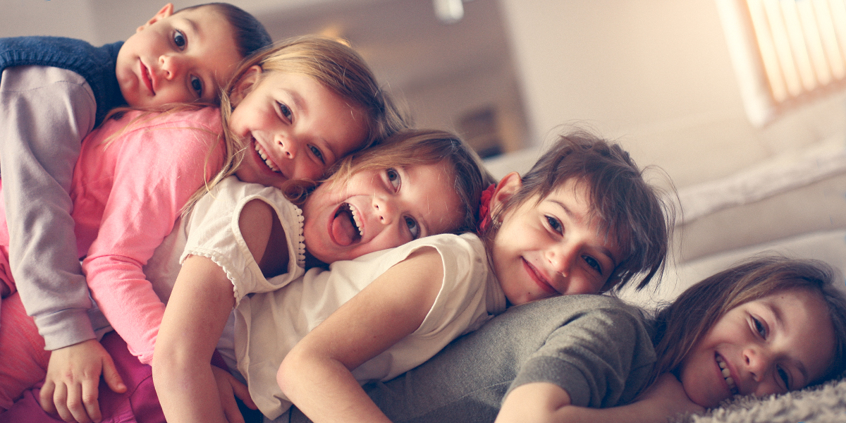 FIVE CHILDREN LAUGHING