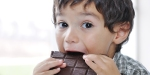LITTLE BOY EATING CHOCOLATE