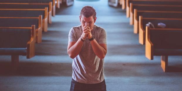 MAN,PRAYING,ALTAR