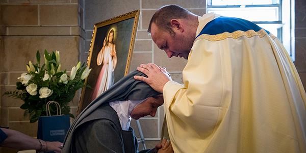 PRIEST BLESSING SISTER
