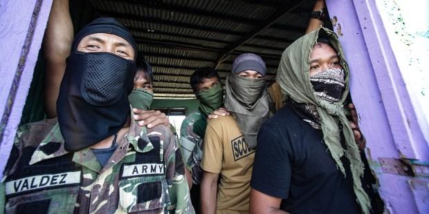 PHILIPPINE REBEL FIGHTERS