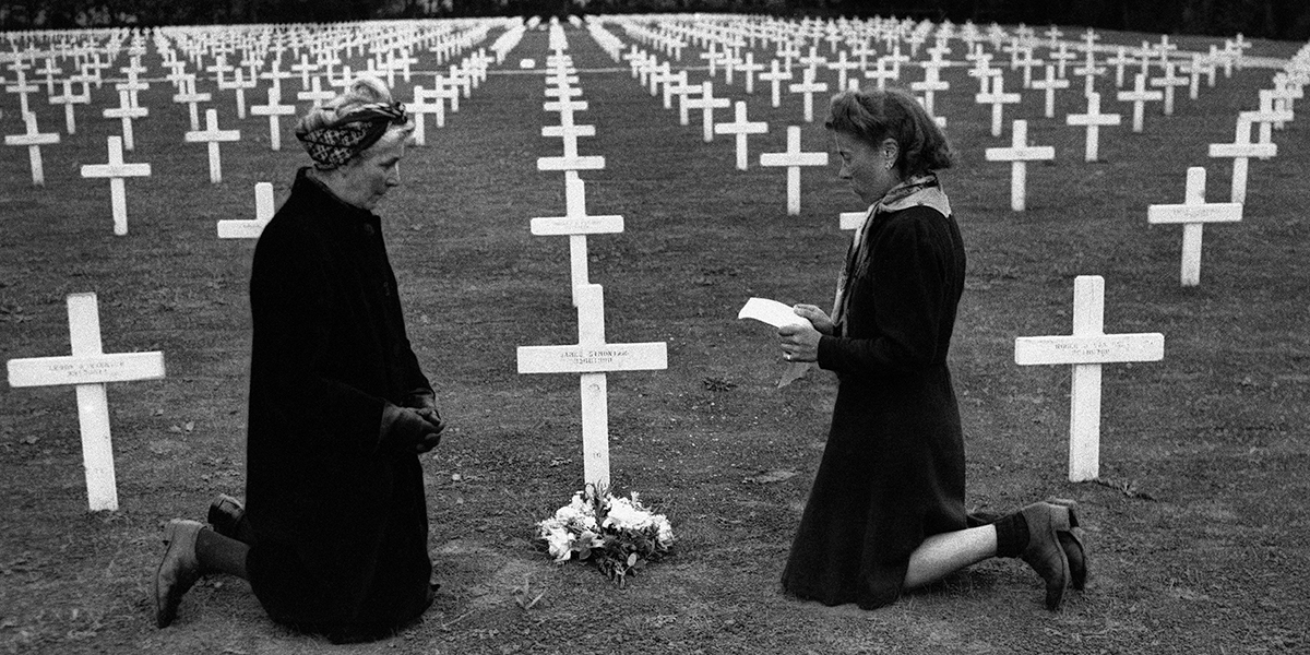 WOMAN PRAYING ON D DAY