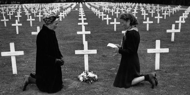 WOMAN PRAYING ON D DAY