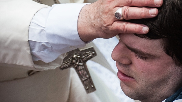 POPE FRANCIS BLESSES DISABLED MAN