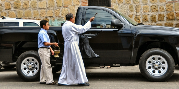 PRIEST BLESSING CAR