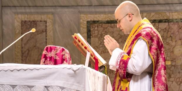 PRIEST SAYING MASS