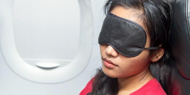 WOMAN,SLEEPING,AIRPLANE