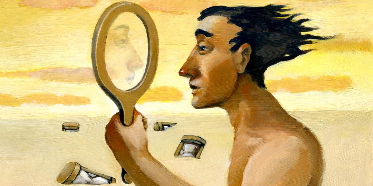 MAN LOOKING INTO MIRROR