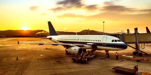 AIRPLANE ON RUNWAY,SUNSET