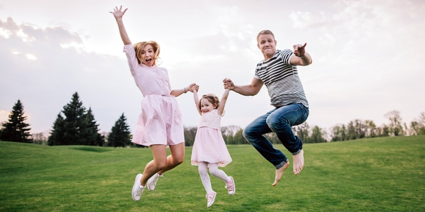 Family Jumping in Field