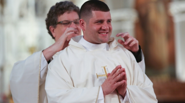 NEWLY ORDAINED PRIEST