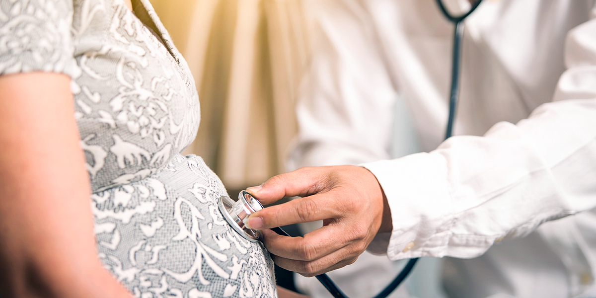 Pregnant Woman and Doctor