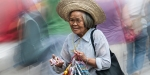 OLD LADY IN MARKET