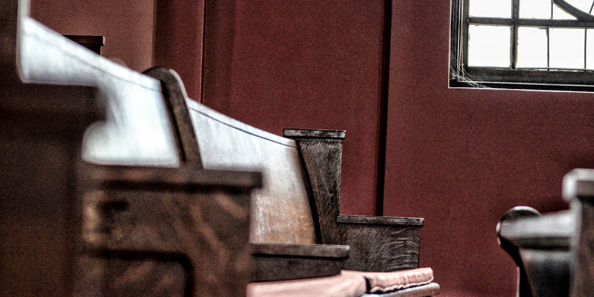 EMPTY CHURCH PEW