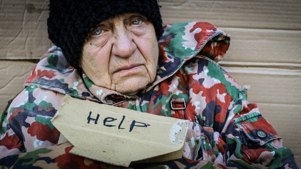 POOR WOMAN WITH HELP SIGN