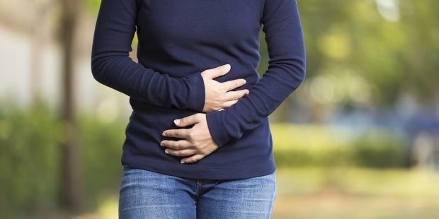 Woman Holding Stomach