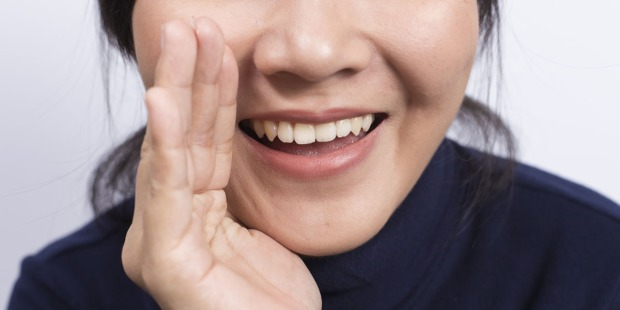 WOMAN,MOUTH,HAND